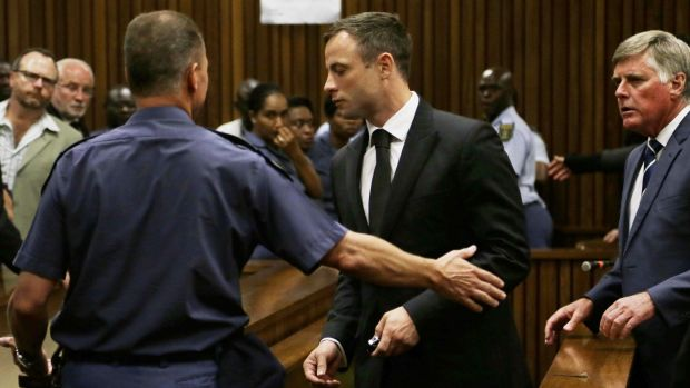 Oscar Pistorius is led out of court after he received a five-year prison sentence for culpable homicide.