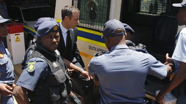 Oscar Pistorius is loaded into a police van after being sentenced to five years' jail time for killing girlfriend Reeva ...