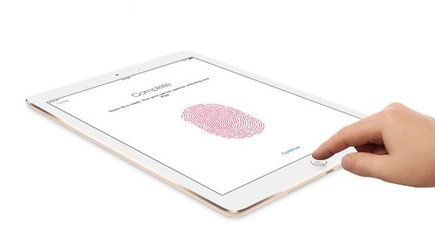 Apple's Touch ID technology uses a fingerprint identity sensor to unlock the iPad Air 2.