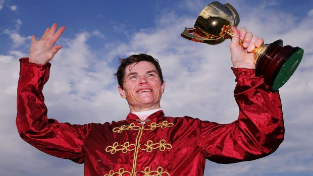 Craig Williams celebrates after winning the Geelong Cup on Caravan Rolls On.