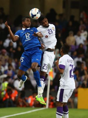 In dispute: Al-Hilal forward Nasser Al-Shamrani (left) contests the ball in his side's ACL semi-final against Al Ain.