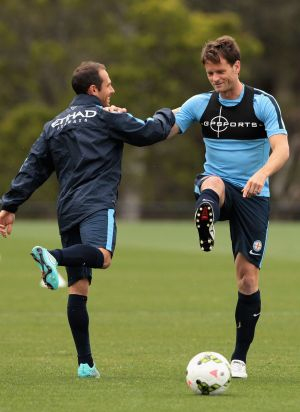 On the right track: Rob Wielaert (right) stretches during a Melbourne City training session.