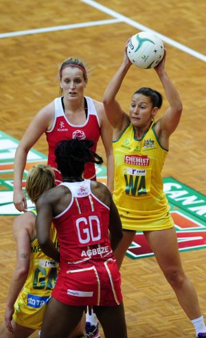 England player Sarah Bayman looks on as  Australian Diamonds player Madi Robinson looks to pass.
