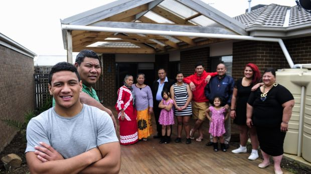 Patrick Mago with his father Pele and extended family in Macgregor.