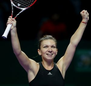 Simona Halep celebrates after defeating Serena Williams.