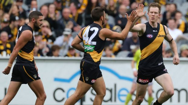 High five: Fans will see plenty of  the Tigers at the MCG.