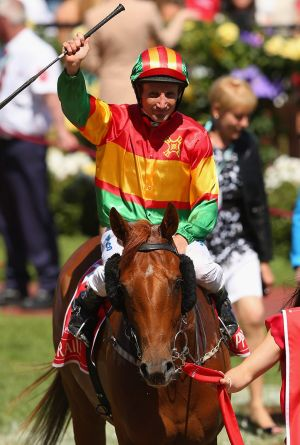 Damien Oliver riding Happy Trails.