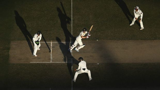 Pakistan's fielders make life uncomfortable for Chris Rogers.