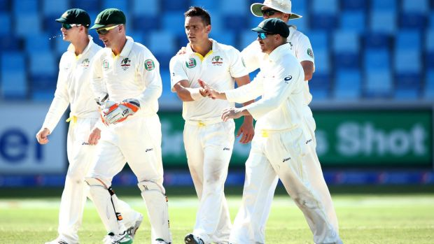 O'Keefe is congraulated by teammates after the wicket of Yasir Shah.
