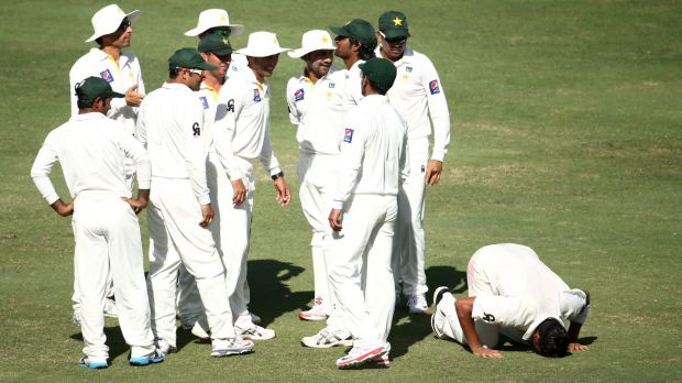 Yasir Shah drops to th floor after dismissing Australian youngster Steve Smith, one of his three wickets for the innings.