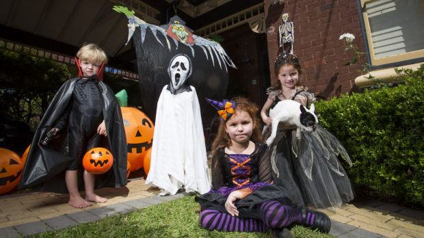 In the spirit: Josh Waite, 3, Lachlan Waite, 5, Alex Gemenis, 6, and Helena Gemenis, 4, prepare for Halloween.