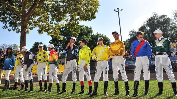 Jockeys pose for the cameras before the Cox Plate.