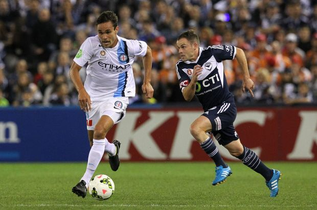 City's James Brown is chased by Leigh Broxham.