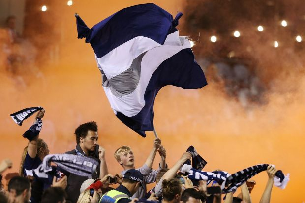 Melbourne Victory supporters rejoice after a goal.