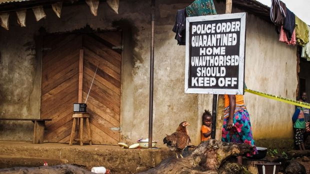 Infection control: A quarantined home in Sierra Leone.