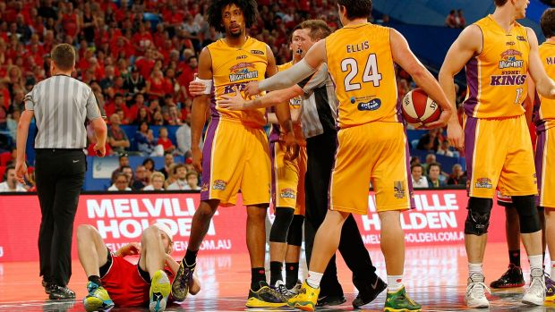 Big hit: Josh Childress is restrained after fouling the Perth Wildcats' off the ball at Perth Arena.