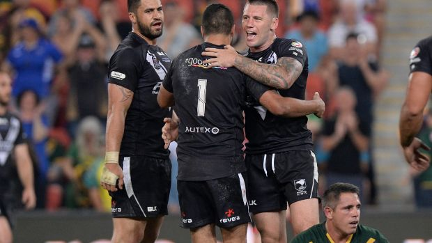 Kangaroo cull: Corey Parker cuts a disconsolate figure as New Zealand celebrate victory on Saturday night.