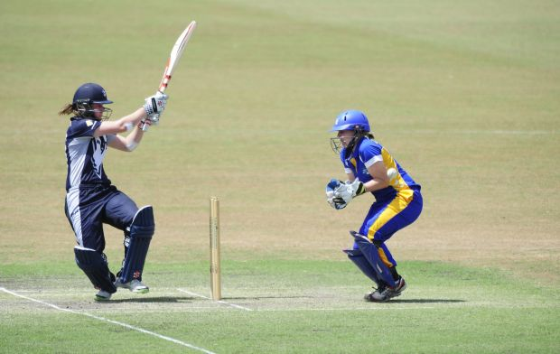 From left, Victoria Spirit batter Anna Lanning and ACT Meteors wicket keeper Laura Wright in action.