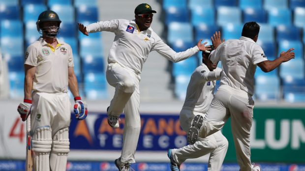Over and out: Chris Rogers is bowled by Imran Khan in the second innings of the first Test in Dubai.