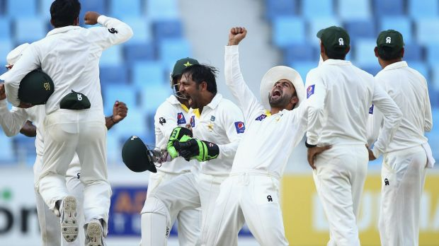 Sheer delight: Pakistan celebrate their crushing win over Australia in the first Test.