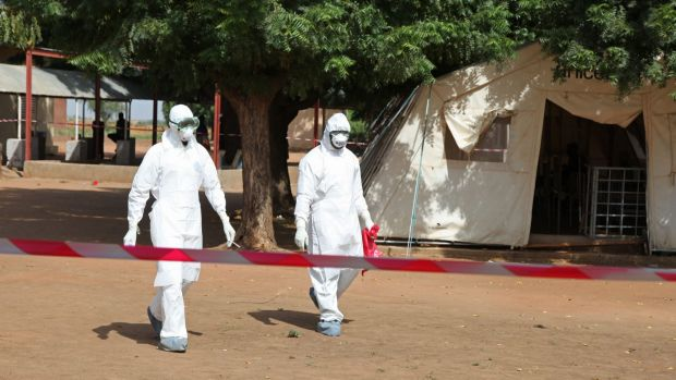Suited up: Health workers at an Ebola treatment centre in Mali.