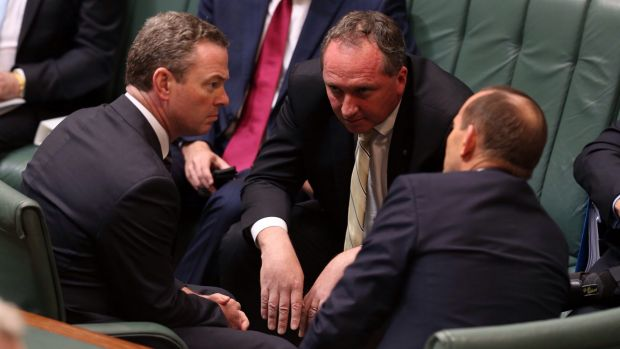 Agriculture Minister Barnaby Joyce consults with leader of the house Christopher Pyne and Prime Minister Tony Abbott ...