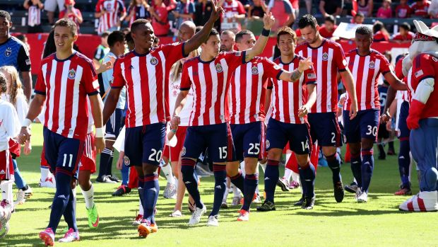 Chivas USA players wave to fans before a game this season.