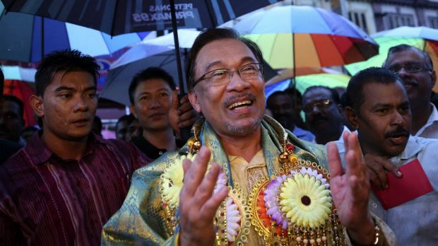 Malaysia's opposition leader Anwar Ibrahim sings on a street in Klang, near Kuala Lumpur, as part of a campaign to seek ...