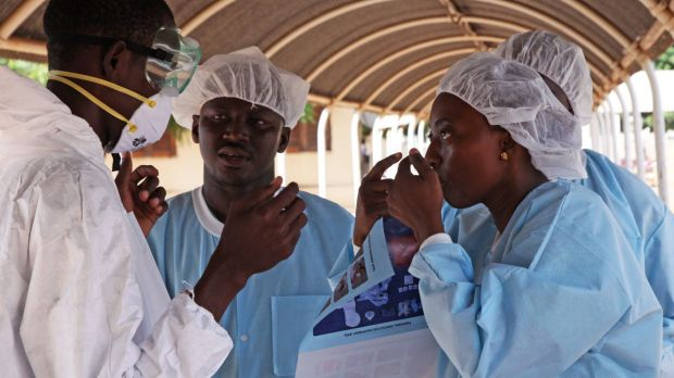 Monitoring symptoms: Health workers at an Ebola treatment centre in Mali.