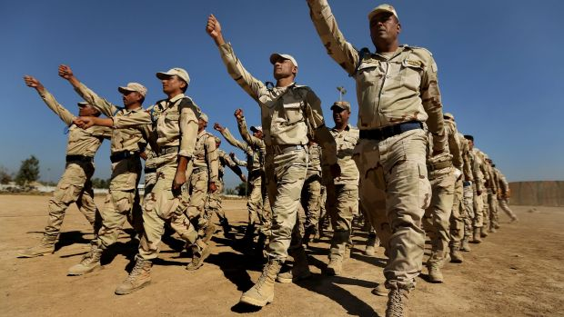 Real soldiers: Iraq army recruits march during their training at Baghdad Combat School.