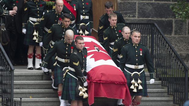 Pallbearers carry the coffin of Nathan Cirillo after his funeral service.