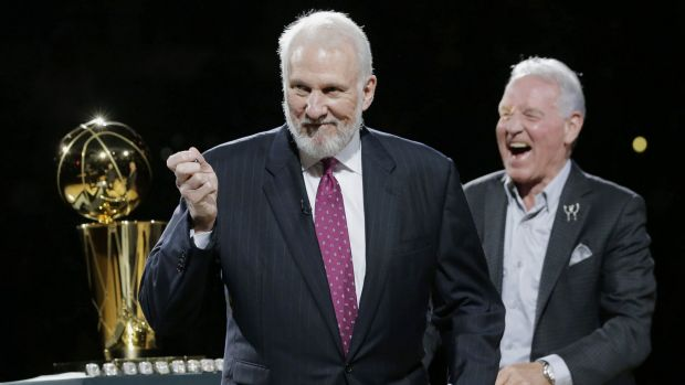 Lord of the rings: Gregg Popovich shares a laugh with Spurs owner Peter Holt at the team's championship ceremony on Tuesday.
