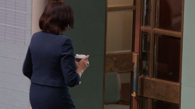 Admonished: Henderson departs with her takeaway flat white.
