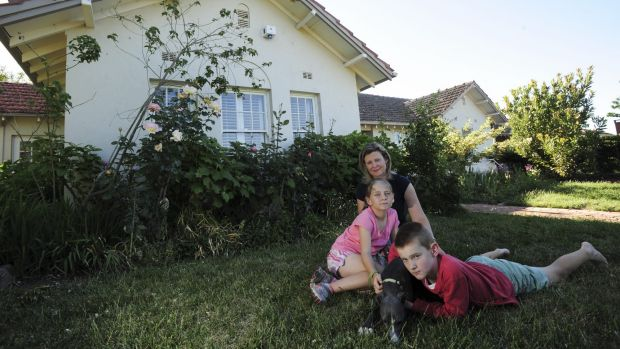 'NO ONE CAN SAVE IT NOW': Fluffy homeowner Karen with her children Scarlett, 10 and Daniel, 12, and the family dog Gary ...