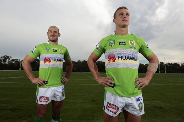 Canberra Raiders players Terry Campese and Jack Wighton wearing the club's Legacy jersey.