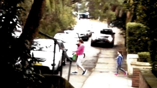 """This picture shows """"a conflict between vehicles using the service road and residents exiting a house with a frontage to ..."""