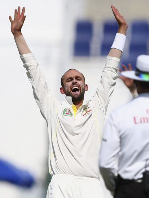 Nathan Lyon of Australia celebrates after taking the wicket of Ahmed Shehzad.