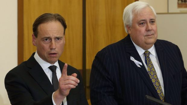 Greg Hunt and Clive Palmer in 2014, when their deal led to the climate change review.