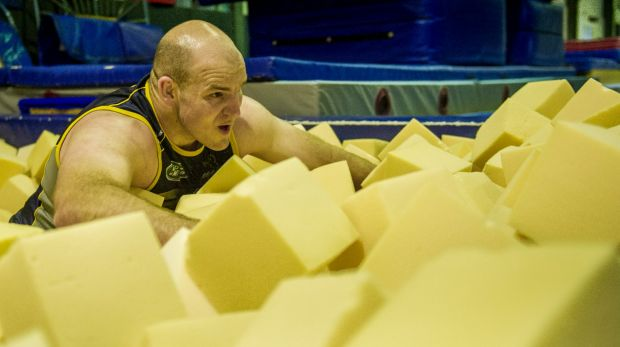 Stephen Moore works out in a foam pit as part of his recovery from knee surgery.