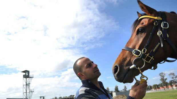Trainer Saab Hasan with racehorse Shoreham.