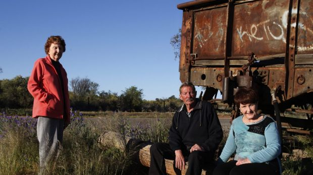 """Siblings Lorraine Cole, Barry """"Fred"""" Cowie and Peggy Corney visit the site of the Broken Hill picnic train attack where ..."""