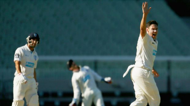 Scott Boland appeals successfully for the wicket of Josh Lalor of New South Wales.