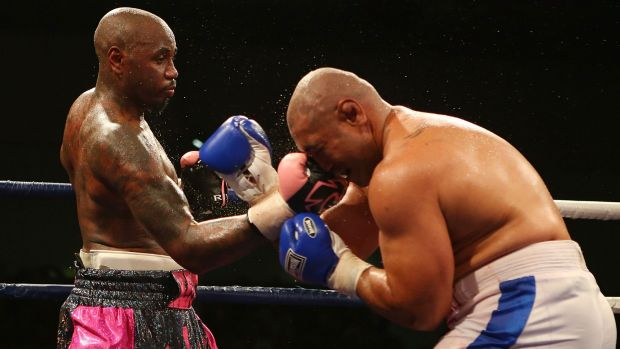 Malik Scott dishes out punishment to Alex Leapai during the heavyweight fight at the Logan Metro Sports Centre in ...