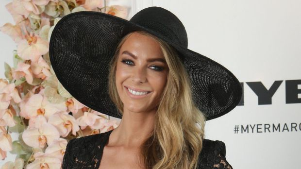 Jennifer Hawkins wore a sun hat to brave the cool conditions at Derby Day.