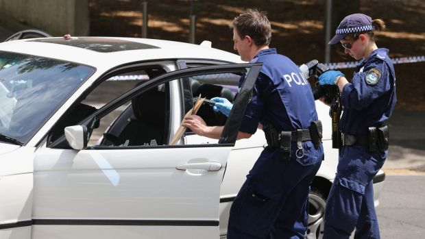 Forensic police remove evidence from the car involved in pursuit across Harbour Bridge.