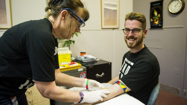 Health check: AIDS Action Council ACT education officer Ben Martin undergoes a sexual health test at the hands of ...