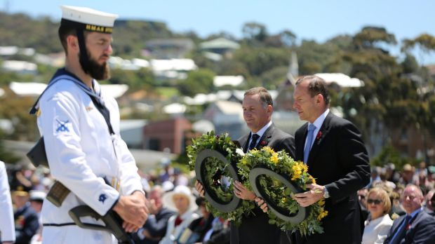 Tribute: Tony Abbott and his New Zealand counterpart John Key lay wreaths at the Anzac Peace Park on Saturday.