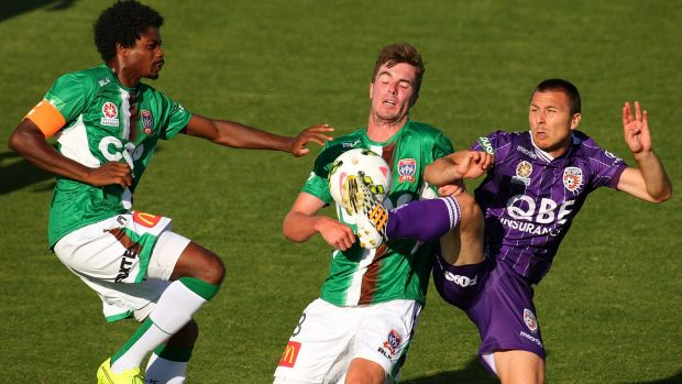 Nebojsa Marinkovic of Perth Glory matches wits with Kew Jaliens and Allan Welsh of the Jets during the round four ...