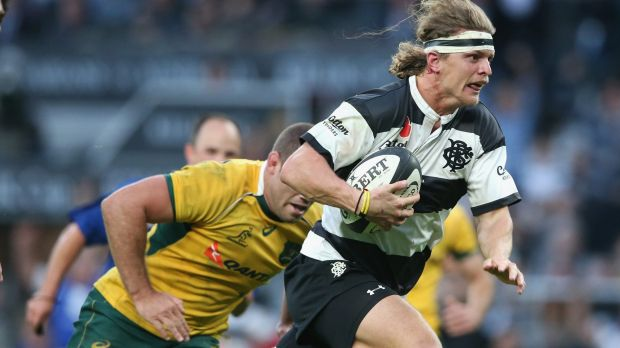 On the burst: Nick Cummins breaks clear to lead the Barbarians fightback.