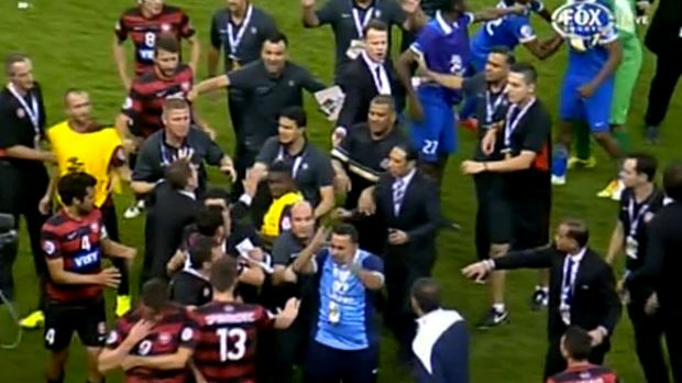 The players are kept apart after tensions boiled over.